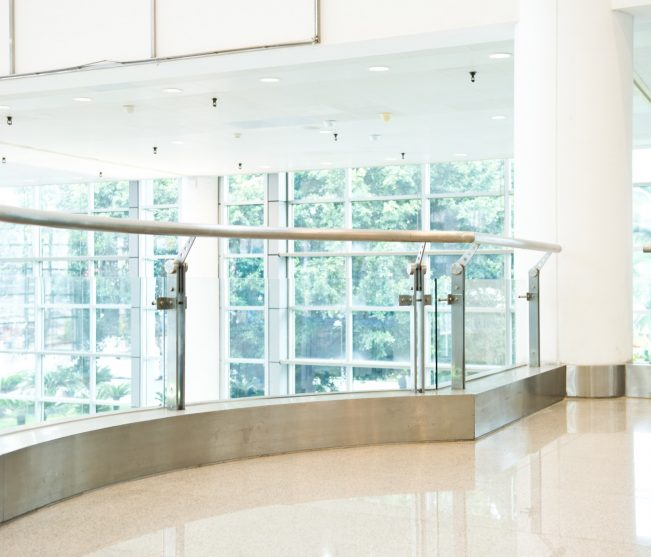 Office featuring multiple types of glass railings
